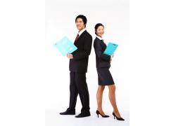商务男女拿着文件夹背对背